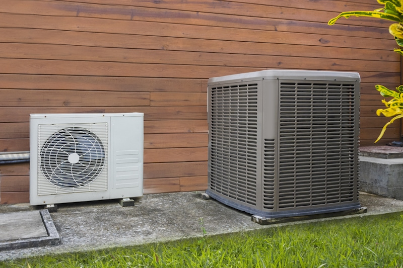 Air conditioning heat pumps on the side of a house in Southampton, PA in need of a chemical wash